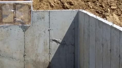 basement wall forms concrete cracks in a newly constrcuted basement wall