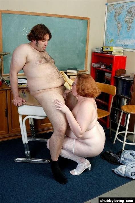 Fat redhead mature teacher giving a blowjob in the ...