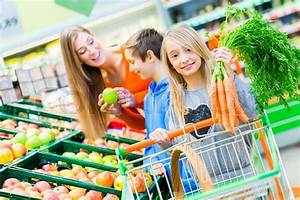 Family selecting fruits and vegetables while grocery ...