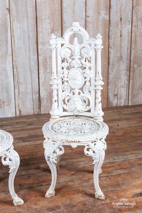 pair  ornate cast iron garden chairs