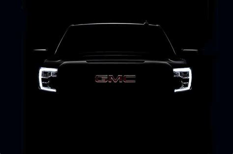 gen  gmc sierra  teases  headlights