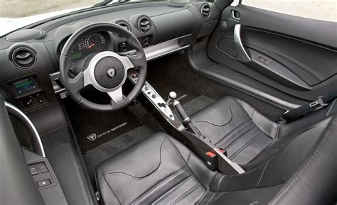 tesla roadster interior car and driver