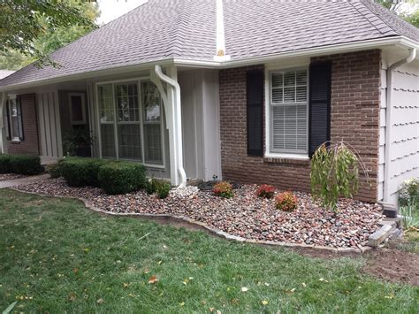 rock bed and rock edging drainage solution landscape