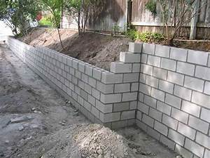 Cinder Block Retaining Wall-leave it plain, so the kids