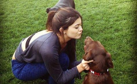 kylie jenner smothers  dog  kisses  science