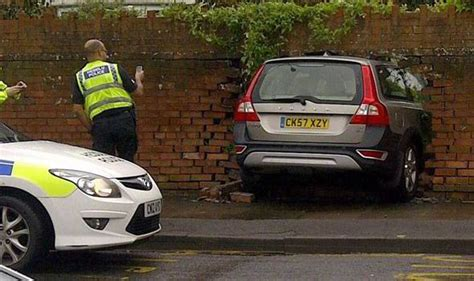 driver crashes  cardiff garden wall