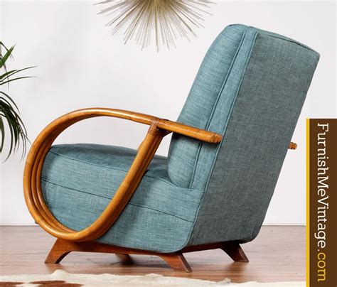 Wooden structure of the seat and rattan backrest, oak armrests, soft cushions and legs provides comfort and support. Restored Mid Century Modern Rattan Rocking Chair