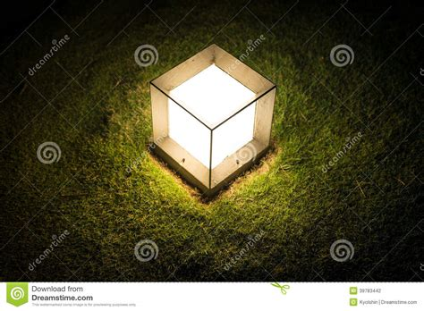 lighting cube lantern on grass at stock photo