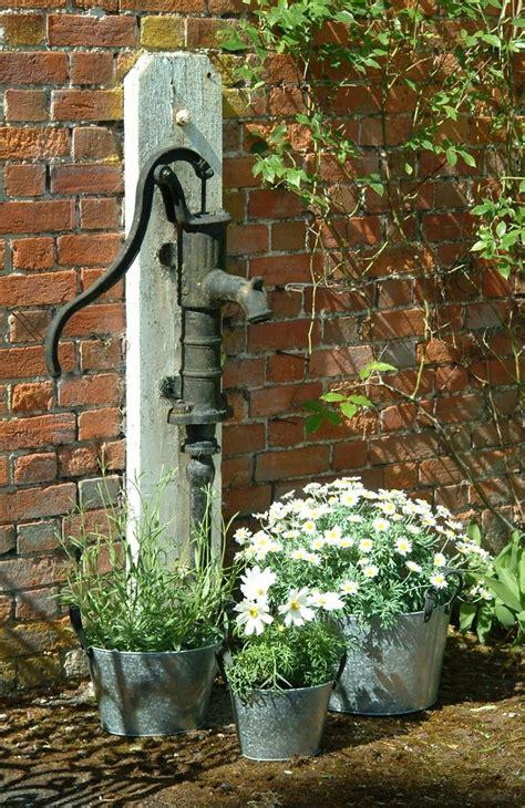 garden decor  water hand pump  galvanized bucket