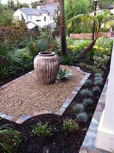 Gräser Im Garten Gestaltungsideen : graeser garten gartengestaltung palmen kies krug blumen pflanzen zuk nftige projekte ~ Eleganceandgraceweddings.com Haus und Dekorationen