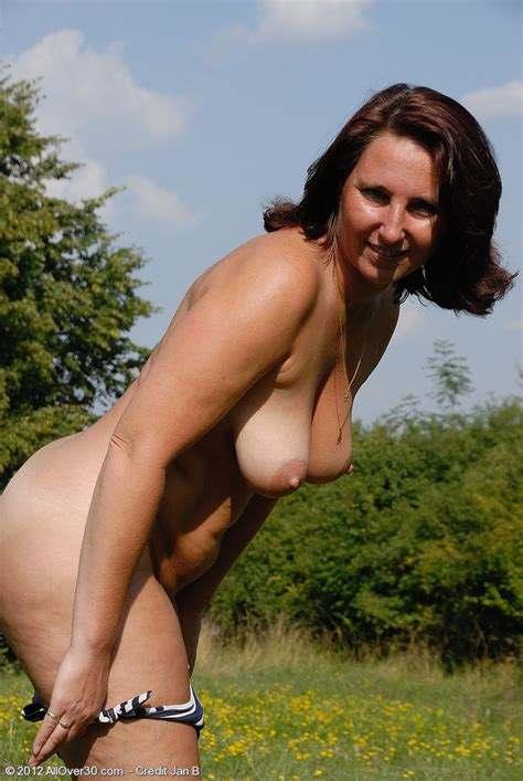 redhead milf demi strip naked at the outdoor big tit avenue