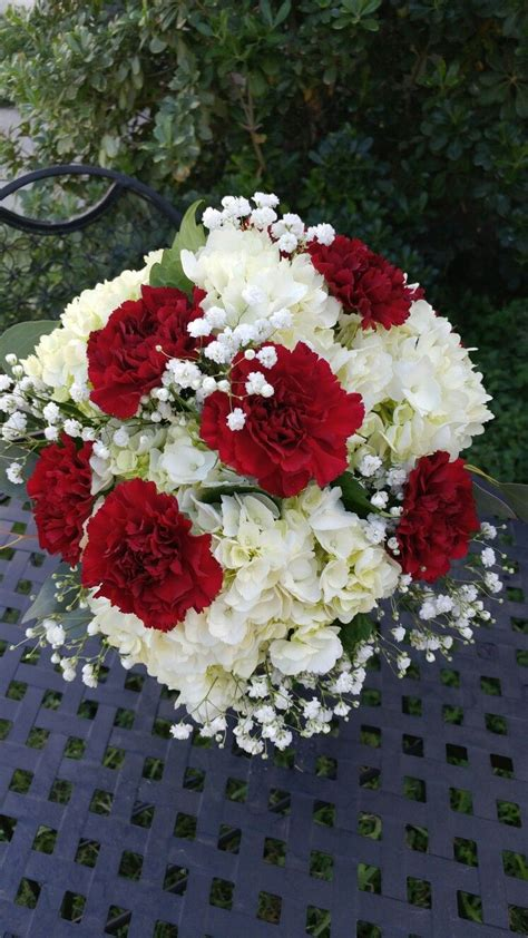 white hydrangea burgundy carnations  babies breath