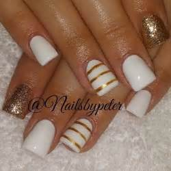 White and gold nail art design in minimalist the nails are