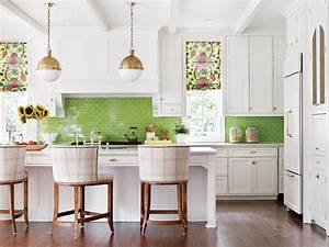 a white kitchen with green tile backsplash With kitchen colors with white cabinets with pink bathroom wall art