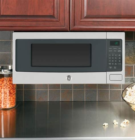 microwaves that can be mounted under cabinets under cabinet mounted microwave kitchens pinterest