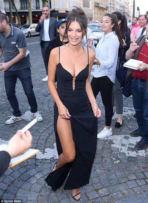 Emily Ratajkowski wears plunging dress at Vogue bash ...
