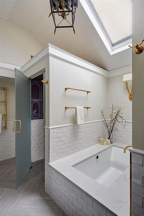 vaulted ceiling   master bathroom features  skylight