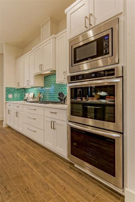 modern white kitchen  teal backsplash hgtv