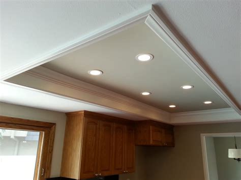 Custom recessed lights replace the old fluorescent light