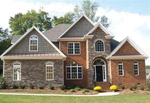 Red Brick Homes with Stone Accents