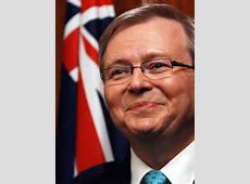 Kevin Rudd smiling with Australian flag in background