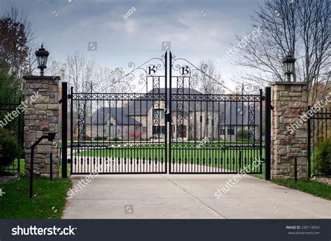 fancy entrance gates fancy large mansion behind locked gate stock photo 230118943 shutterstock