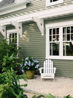 green house  cream trim black accents  brown roof