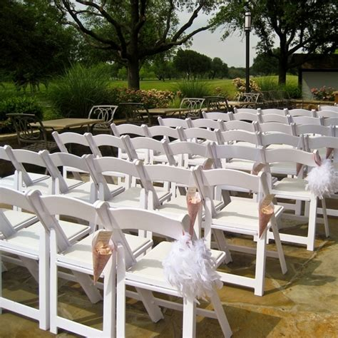 white resin americana folding chair for wedding ceremony