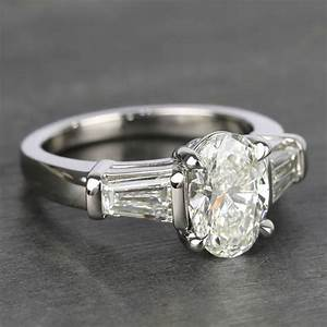Oval Diamond Ring With Large Tapered Baguette Diamonds