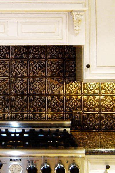 Bronze backsplash, white cabinets, rubbed bronze hardware