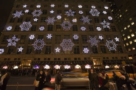 saks fifth avenue in new york city lights up with holiday cheer facility executive creating
