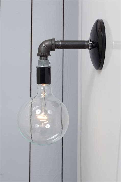 industrial black pipe wall sconce light bare bulb l