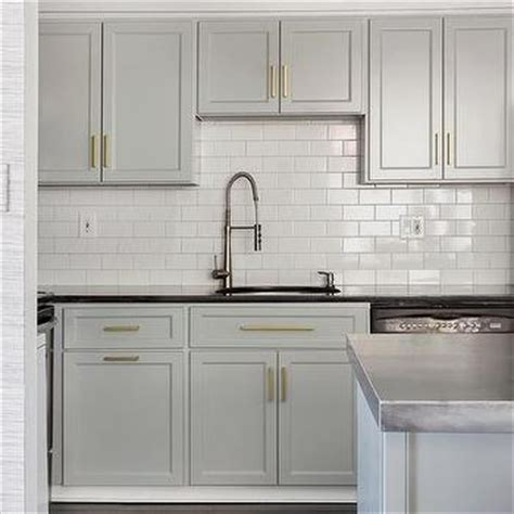 coventry kitchen cabinets gray kitchen peninsula with white and gold stools