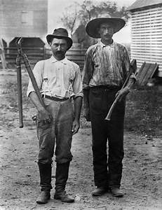 1890s 1900s 2 Men On Farm In Work Clothes One Holding ...
