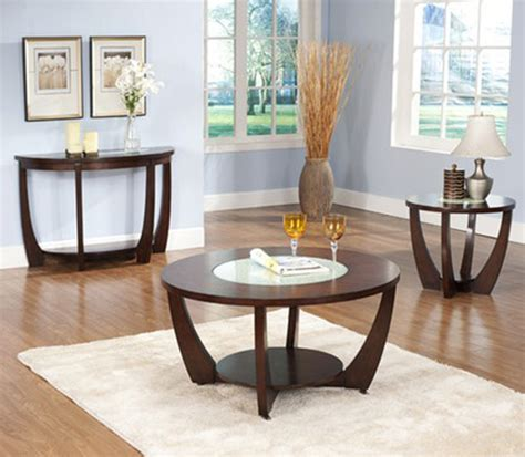 Give your living room an instant constellation of style with the ultra sleek steve silver orion oval chrome and glass coffee table set. Steve Silver Rafael 3-Piece Round Coffee Table Set in Cherry traditional-coffee-table-sets