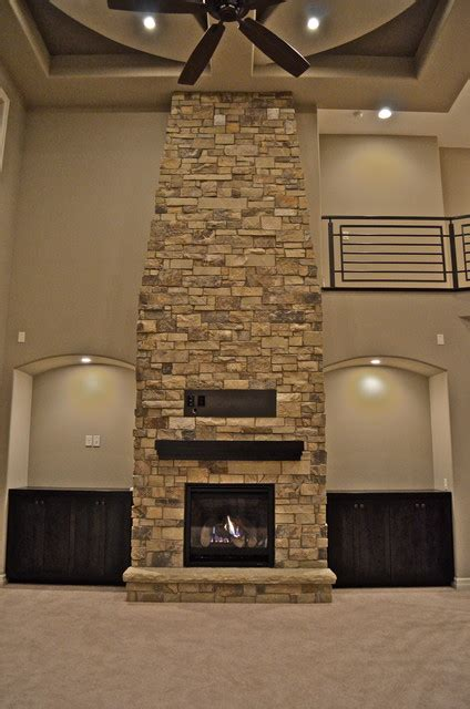 floor  ceiling fireplace contemporary living room