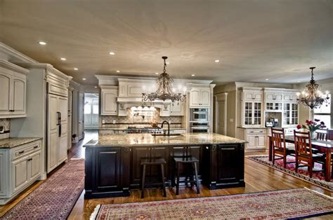 painted kitchen featuring oversized black island