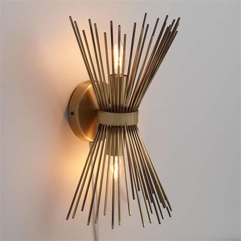 wall sconce brass starburst logan wall sconce world market