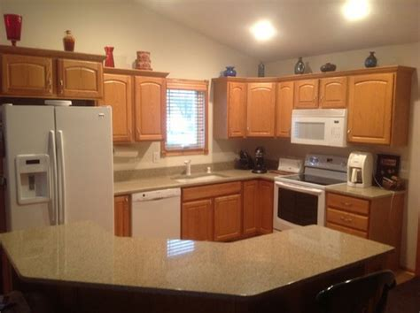 what goes where in kitchen cabinets kitchen cabinets leave honey oak or paint white mocked 9636