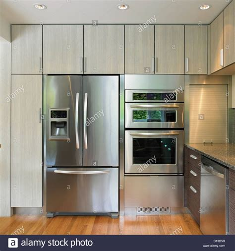 around the kitchen in the refrigerator light kitchen wall featuring built in fridge and wall oven 9947