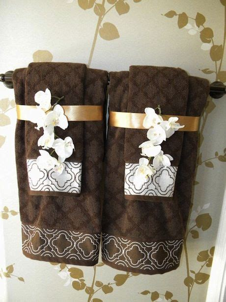 bathroom towel decorating ideas sew decorative trim to your towels and add coordinating