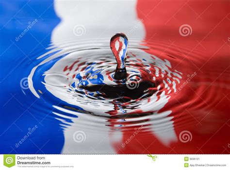 Water Droplet Against A French Flag Stock Image