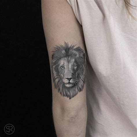 lion head tattoo      left arm tricep