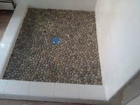 Installing Shower Stall by Plush Interlocking Grey Random Sized Pebble Shower Floor