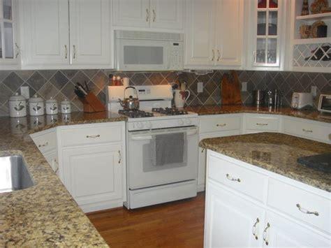 granite countertops tile backsplash stainless steel sinks