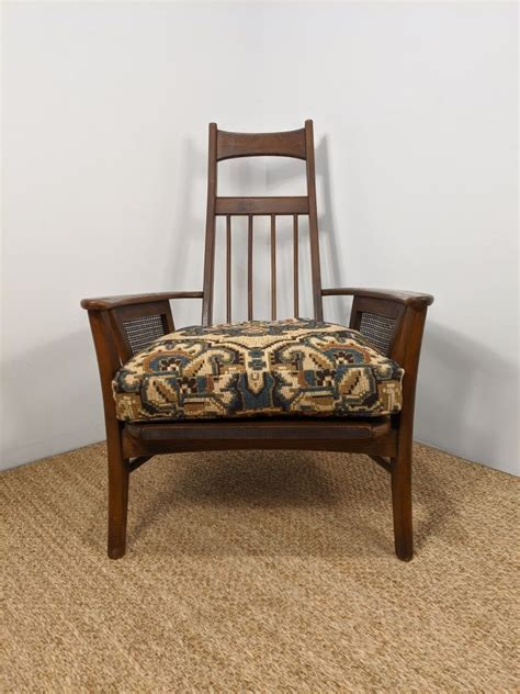 During the height of the british empire in the 19th century, bamboo and other tropical furniture were extremely popular. Mid Century Walnut & Rattan High-back Lounge Chair - EPOCH