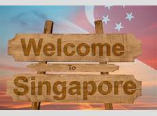 Welcome To Singapore Sign On Wood Background With Blending