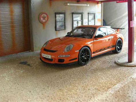 orange porsche 911 gt3 rs porsche 997 gt3 rs miniature orange jantes autoart 1