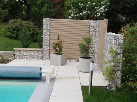 Garten Sichtschutz Mit Steinen by Holz Stein Rembart Holz Im Garten
