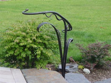 hand made sculptural hand railing by rising sun forge